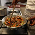 Happiness cooking dinner for a guest at Charity Hotel in the Orphans Foundation Fund street children project