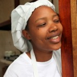 Elina taking a break from cooking at Motel 2000 in the Orphans Foundation Fund street children project