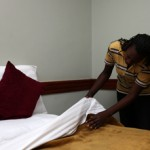 Violet doing Housekeeping at Charity Hotel in the Orphans Foundation Fund street project