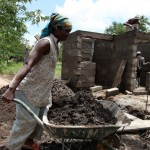 Woman working on the Njiro construction site of Orphans Foundation Fund in Arusha Tanzania Africa